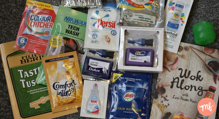 Selection of free stuff for the home, including free Ariel and Persil washing powder, free recipe books and free Dulux paint
