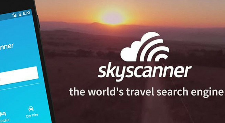Sunset background with skyscanner logo and tagline underneath