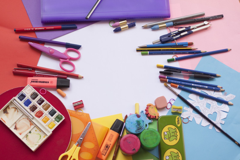 Collection of different back to school stationery, including highlighters, pens, scissors, pencils and more