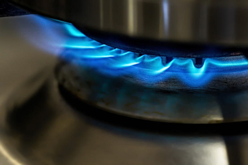 Close up of blue flame from a kitchen hob