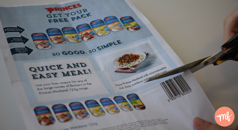 Pair of scissors cutting a Princes tuna coupon