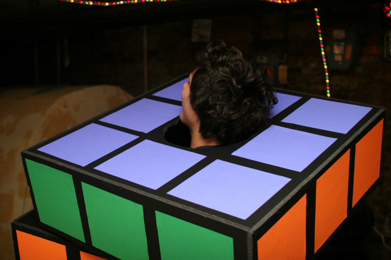 Close up of the back of a man in a Rubik's Cube Halloween costume