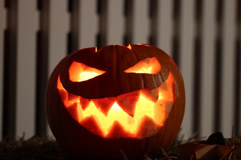 Close up of a lit up carved Halloween pumpkin