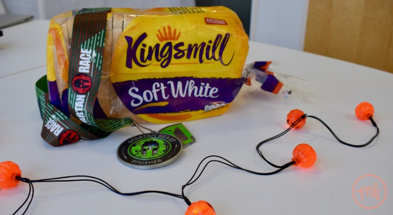Medal and loaf of Kingsmill bread on a white table with pumpkin fairy lights around
