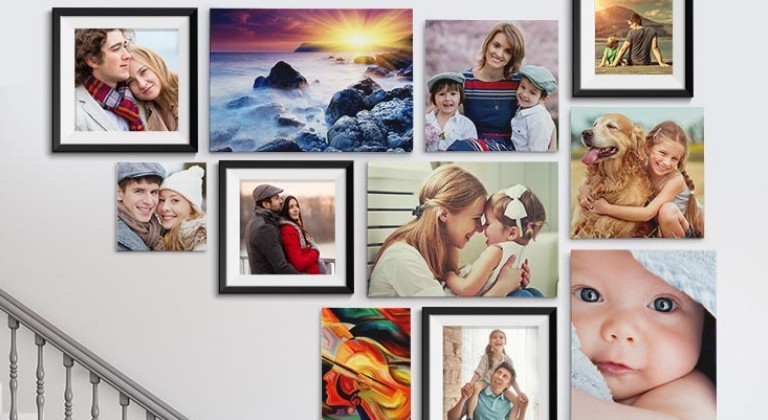 Collection of canvas photo prints on a staircase
