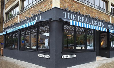 "<span class=""merchant-title"">The Real Greek</span> 